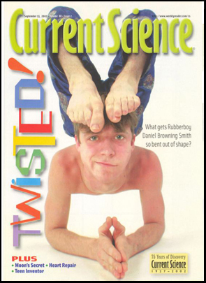 Daniel in a contortionist elbow stand on the cover of Current Science
